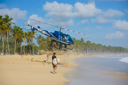 Macao beach. Dominican Republic October 7, 2015. An excursion helicopter takes off over the beautiful Caribbean coast Фото со стока - 139316930
