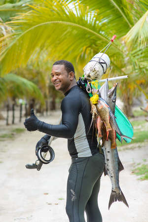 Spearfishing in the tropics. fisherman with a fish. Dominican Republic Punta Cana 20.09.2015 Редакционное