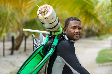 Spearfishing in the tropics. fisherman with a fish. Dominican Republic Punta Cana 20.09.2015 Фото со стока - 139316950