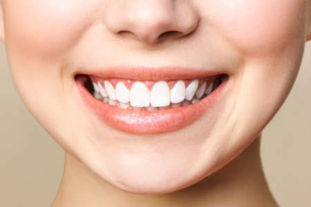 Perfect healthy teeth smile of a young woman. Stock Photo