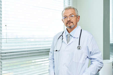 Medical doctor or physician in white gown uniform with stethoscope in hospital or clinic