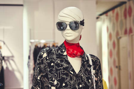 Photo female clothes on a mannequin with bag. Concepts of shopping clearance sale. Big discounts Редакционное