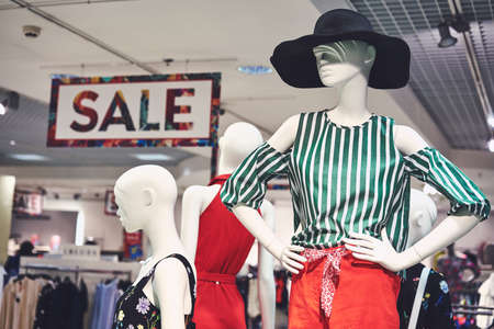 Photo female clothes on a mannequin with bag. Concepts of shopping clearance sale. Big discounts. Saint Petersburg 07.2019. Фото со стока - 139317258