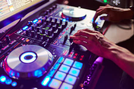 Dj mixes the track in the nightclub at a party Фото со стока - 139178548