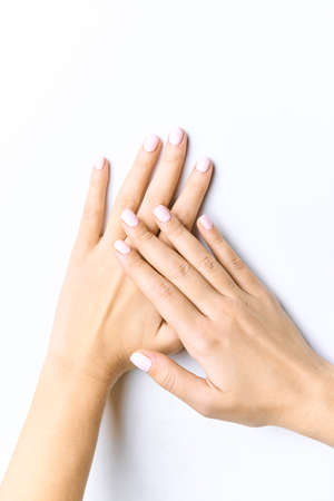 Beautiful female hands. With gently pink manicure. Isolated on a white background Фото со стока - 139782430