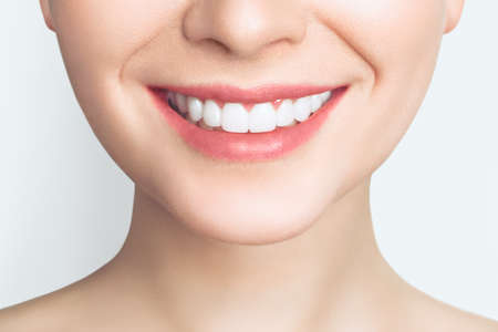 Perfect healthy teeth smile of a young woman. Teeth whitening. Dental clinic patient. Image symbolizes oral care dentistry, stomatology. Dentistry image. Stock Photo