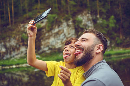 Having fun. Father example of noble human. Taking selfie with son. Child riding on dads shoulders. Happiness being father of boy.