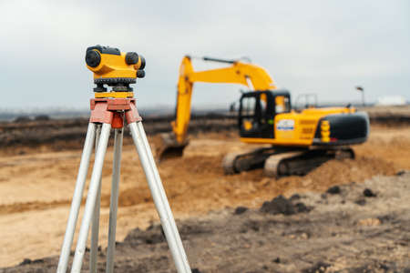 Surveyor equipment tacheometer or theodolite outdoors at construction site.