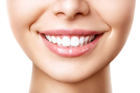 Beautiful female smile after teeth whitening procedure. Dental care. Dentistry concept. Stockfoto