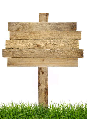 Wood sign with grass isolated on a white Stock Photo - 11253616