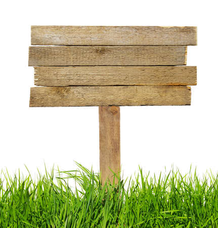 Wood sign with grass isolated on a white photo