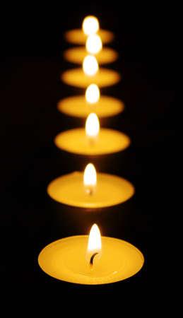 holy night:  burning candle isolated on black background