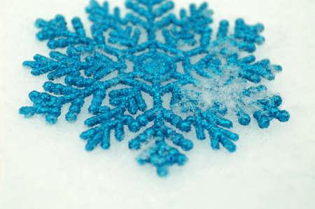Beautiful snowflakes isolated on snow Stock Photo - 11705556
