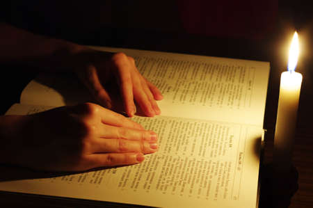 Praying hands on open bible  photo