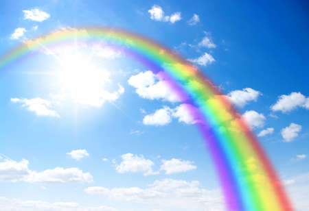 rainbow clouds: A bright rainbow in the sky