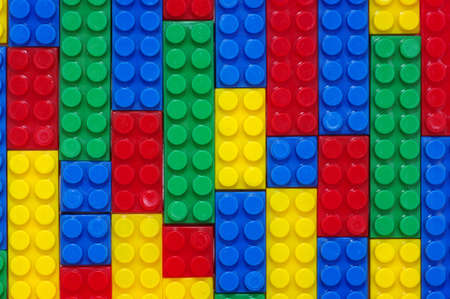 plastic bricks: toy background made with color plastic bricks