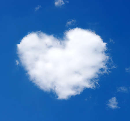 Fluffy cloud of the shape of heart on a blue sky photo