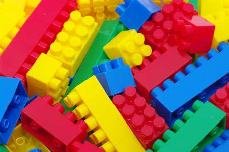 plastic bricks: toy background made with color plastic bricks