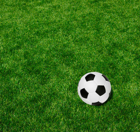 Soccer ball on the green lawn photo