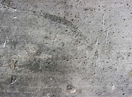 damaged cement: texture of gray concrete wall