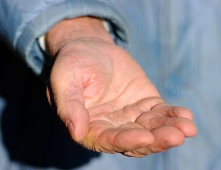hands of a beggar with coins Banco de Imagens