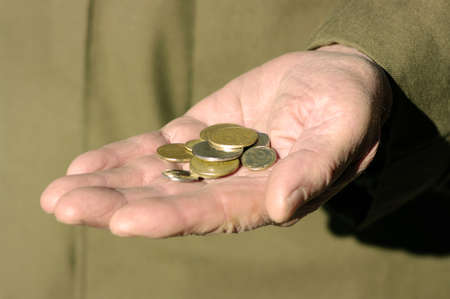 hands of a beggar with coins Stock Photo - 17131919