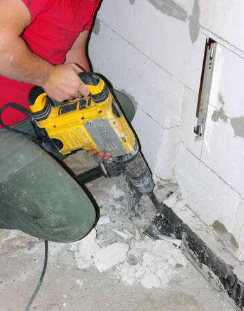 Jackhammer in the worker hands photo