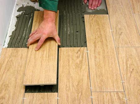 Man installs ceramic tile  photo