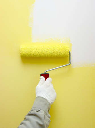 Female Hand Roller Painting A White Wall Stock Photo, Picture And ...
