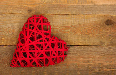 heartfelt: Red heart on a background of wood