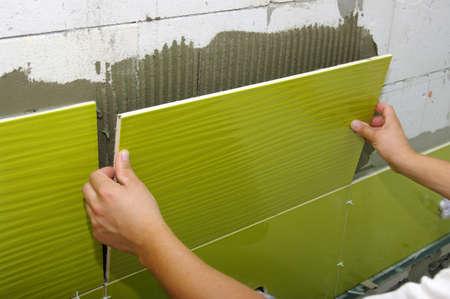 Man installs ceramic tile  Stock fotó