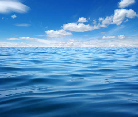 Blue sea water surface on sky 版權商用圖片