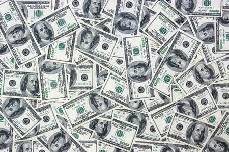 ドル、金背景のヒープ 写真素材