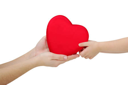 mother gives a red heart in the hands of a child