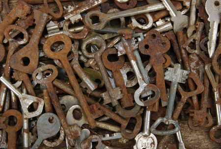 old keys: old keys against wooden background