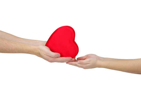 Red heart in hand isolated on white Foto de archivo