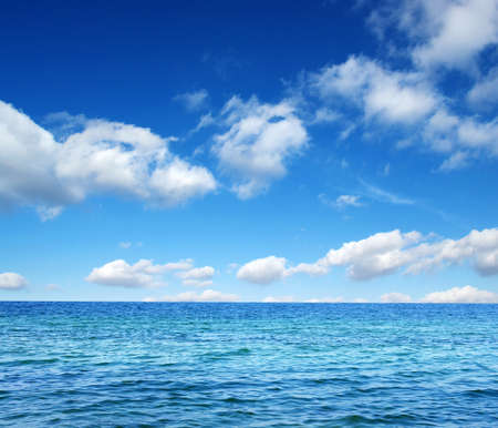 deep sea: Blue sea water surface on sky Stock Photo