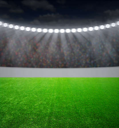 football on the field: the soccer stadium with the bright lights