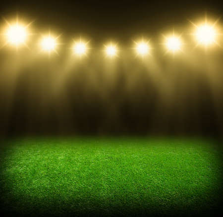 beauty background: the soccer stadium with the bright lights