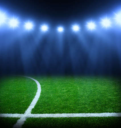 soccer ball on grass: the soccer stadium with the bright lights