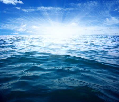 青い海と空に太陽 写真素材
