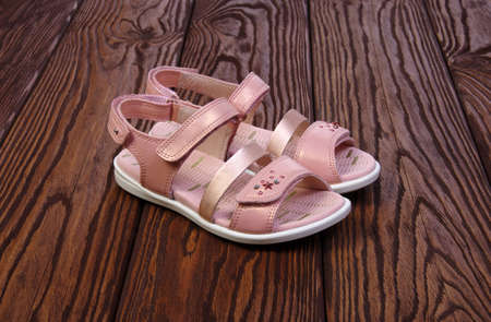 velcro: Childs sandals on a wooden background