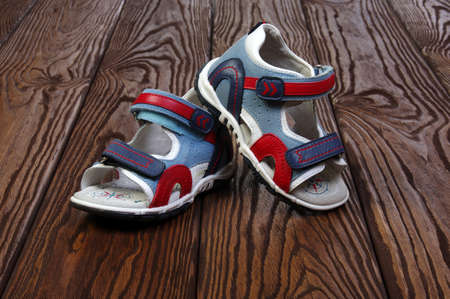 Childs sandals on a wooden background