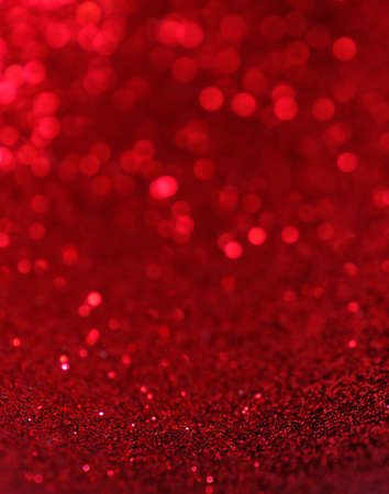 red christmas ball: Defocused abstract red lights background .