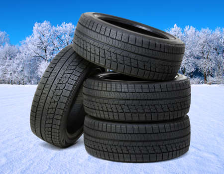 new black tyres for car on snow and frosted trees