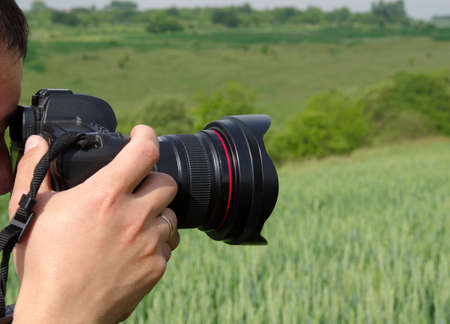 cinematographer: Photographer shoots nature with a camera