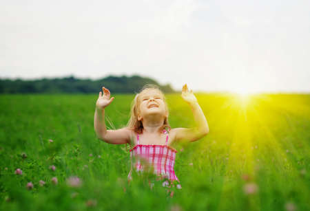 little girl on the meadow in spring day Stock Photo
