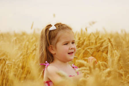 Girl on a wheat field
