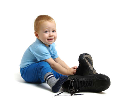 Little boy in fathers shoes