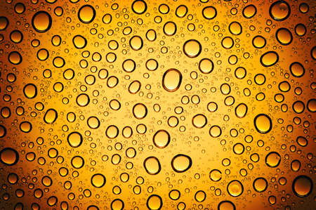 water drops on beer background Фото со стока
